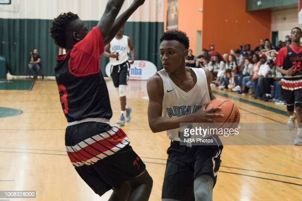 Tremaine Guidry of Seattle Rotary drives to the basket against Alaska Tru Game during the Jr NBA World Championship Northwest Regional Finals on July...