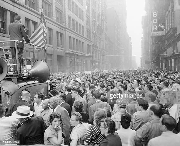 A tremendous throng packs 17th street in New York between Broadway and Fifth Avenue June 19 to listen to speeches condemning the imminent execution...
