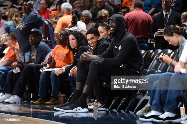 Tremont Waters and Tacko Fall of the Boston Celtics attend the game between the Los Angeles Sparks and the Connecticut Sun on September 17 2019 at...