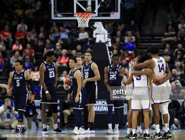 Tremont Waters and the LSU Tigers group up in the first half against the Yale Bulldogs during the first round of the 2019 NCAA Men's Basketball...