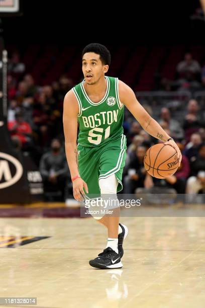 Tremont Waters of the Boston Celtics drives the ball down court during the second half of a preseason game against the Cleveland Cavaliers at Rocket...
