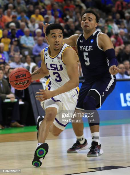Tremont Waters of the LSU Tigers dribbles the ball against Azar Swain of the Yale Bulldogs in the second half during the first round of the 2019 NCAA...