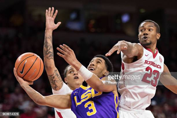Tremont Waters of the LSU Tigers drives to the basket against CJ Jones of the Arkansas Razorbacks at Bud Walton Arena on January 10 2018 in...