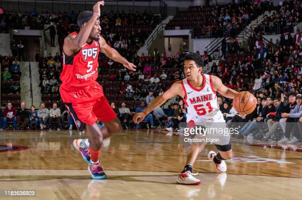 Tremont Waters of the Maine Red Claws dribbles the ball against Paul Watson Junior of the Mississauga Raptors 905 defends on November 20 2019 at The...