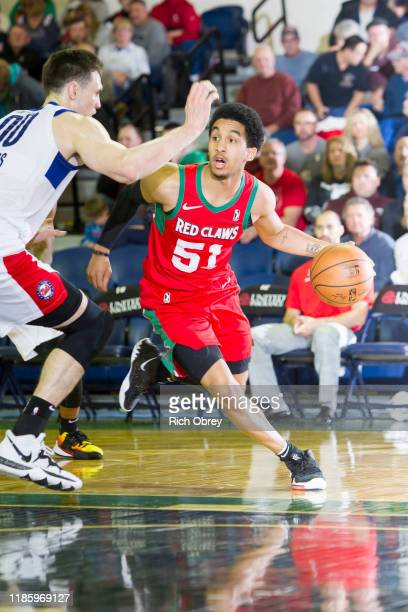 Tremont Waters of the Maine Red Claws drives against Rodions Kurucs of the Long Island Nets on Saturday December 1 2019 at the Portland Expo in...