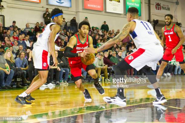Tremont Waters of the Maine Red Claws drives between Jaylen Hands and Angel Nunez of the Long Island Nets on Saturday December 1 2019 at the Portland...