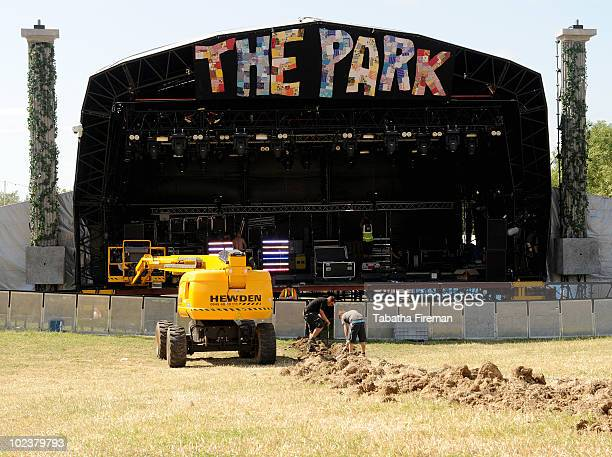 A trench is being dug to lay sound and lighting cables in for The Park Stage on day one of Glastonbury Festival at Worthy Farm on June 24 2010 in...