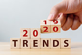 2020 trend concept. Hand flip wood cube change year 2019 to 2020