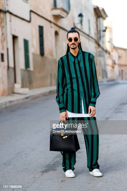 Trend scout Julian Daynov, wearing a green overshirt with black stripes and green pants with black stripes by Wales Bonner, a long white shirt by...