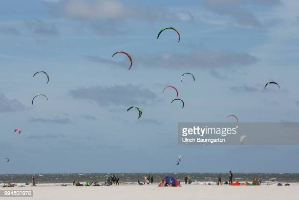 Trendsport kite surfing on the North sea coast in St Peter Ording and the concerns about the habitat of the birds on this strech of coast in the...