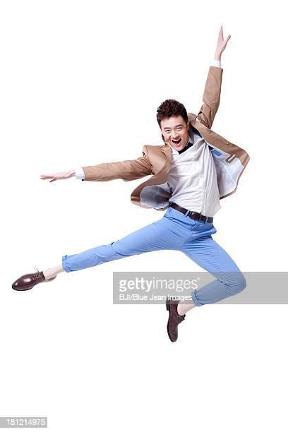 Trendy businessman dancing