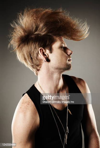 Trendy Caucasian man with unusual hairstyle