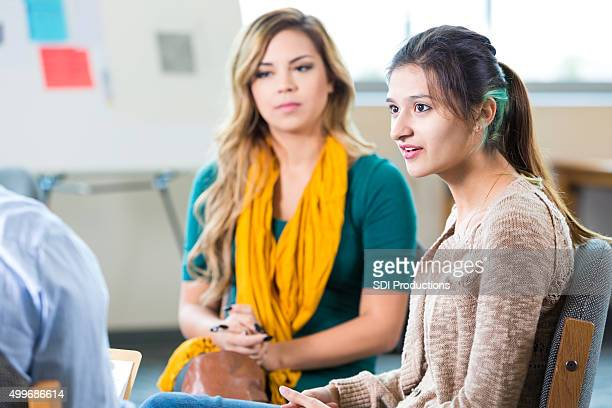 Trendy college age women discussing something in class or therapy