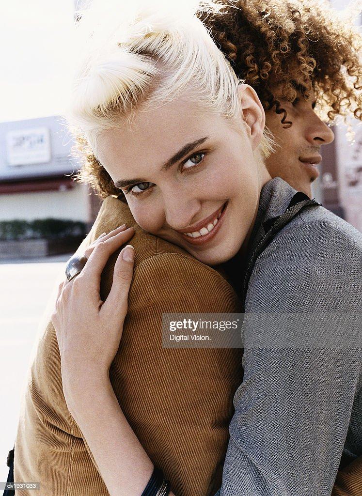Trendy Couple Embracing : Stock Photo