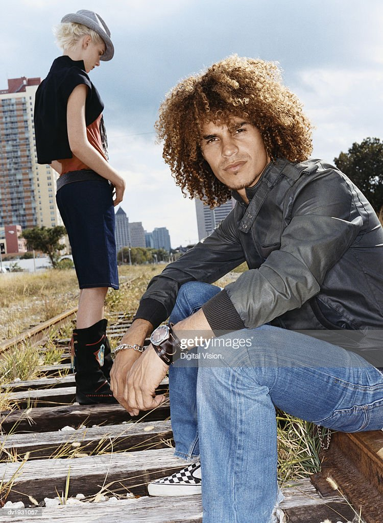 Trendy Couple on Railway Tracks : Stock Photo