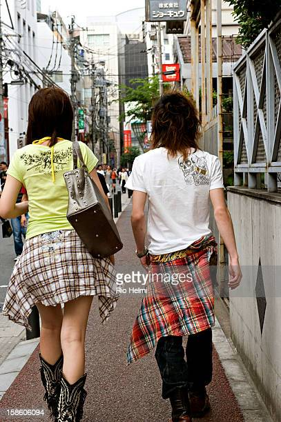 A trendy couple stroll down to the main shopping area of Tenjin in central Fukuoka City