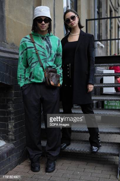 Trendy Couple wearing colourful outfits attend the London Fashion Week Men's Day One Street Style.