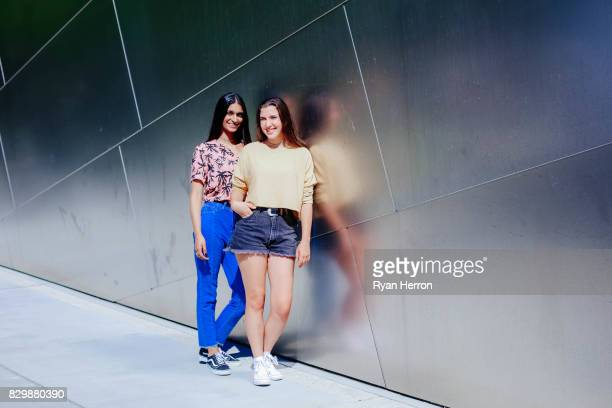 trendy diverse teen friends - asian twins stock photos and pictures