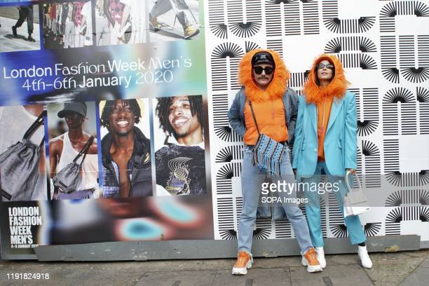 Trendy Fashionistas wearing colourful outfits attend the London Fashion Week Men's Day One Street Style.