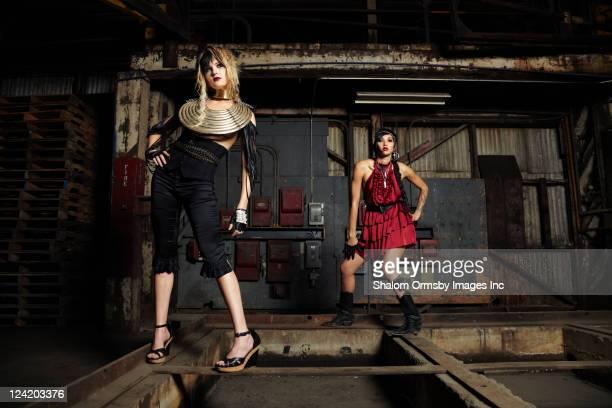 Trendy friends in warehouse