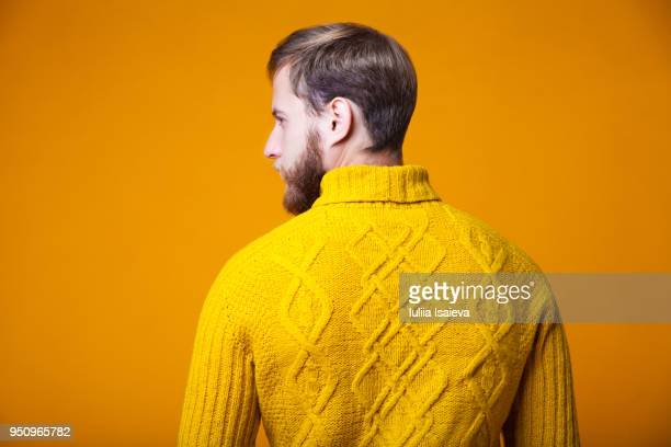 Trendy man in bright sweater