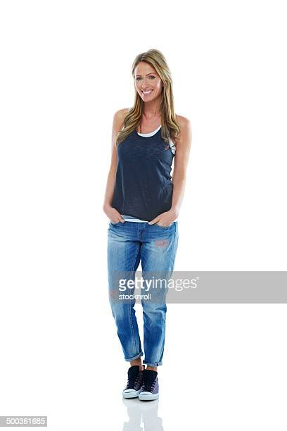 trendy mature woman posing in casuals - sleeveless top stock pictures, royalty-free photos & images