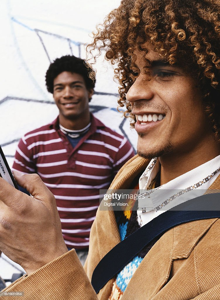 Trendy Men, Man Using a Mobile Phone : Stock Photo