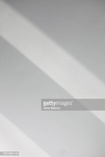 trendy photography effect of sun light reflection over white background for overlay - sunbeam stock pictures, royalty-free photos & images