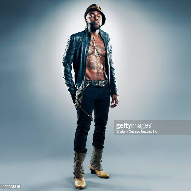 trendy, tattooed african american man - black boot stock pictures, royalty-free photos & images