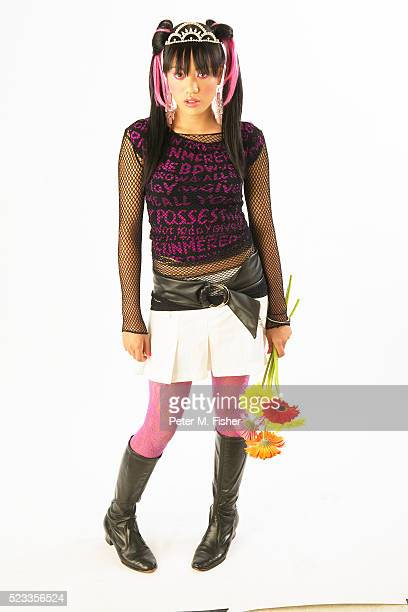 Trendy Teenager Holding Daisies