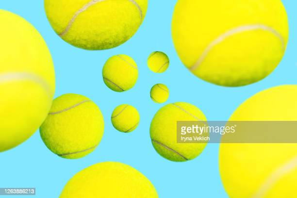 trendy tennis balls levitation on blue green mint background. - tennis ball stock pictures, royalty-free photos & images