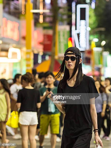Trendy young man in the streets of taipei at night Taiwan
