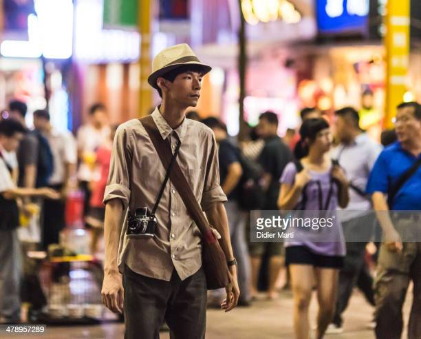 Trendy young man in the streets of Taipei Taiwan