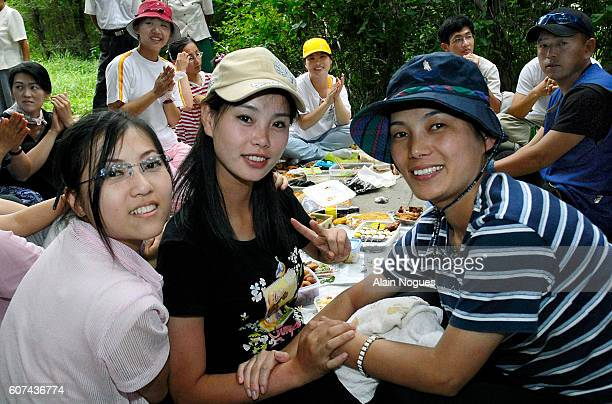Trendy young North Korean women gather with friends for a picnic in a park on Moranbong hill where singing and dancing to a drumbeat take place in a...