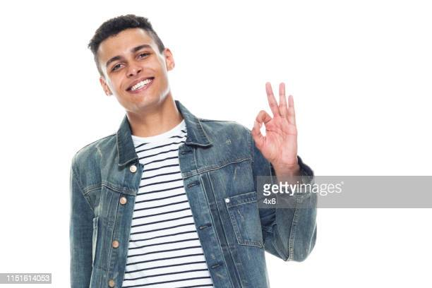trendy young tall african american male wearing denim jacket - ok sign - gesturing stock pictures, royalty-free photos & images