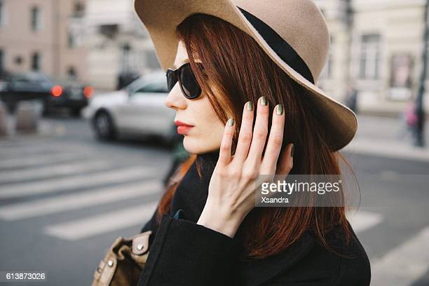 Trendy young woman wearing wool hat