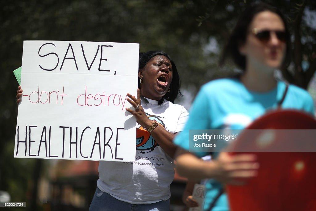 Activists Protest Healthcare Vote Of GOP Rep. Carlos Curbelo In Miami : News Photo