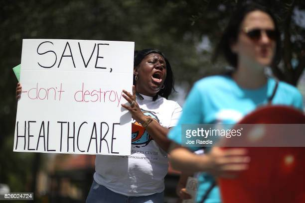 Trenise Bryant joins others for a protest in front of the office of Rep. Carlos Curbelo on August 3, 2017 in Miami, Florida. The protesters are...