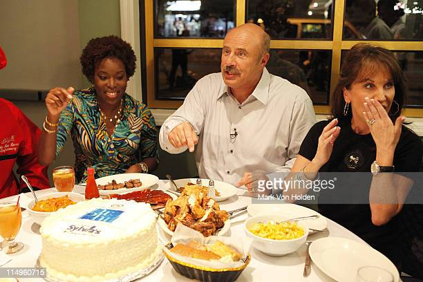 Tren'ness Woods Black Dr Phil McGraw and Robin McGraw enjoy dinner at Sylvia's Soul Food restaurant during the taping of Dr Phil Hits The Streets to...