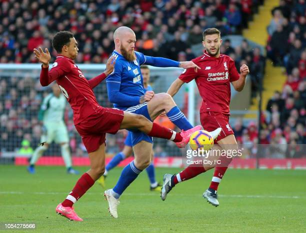 Trent AlendanderArnold of Liverpool and Aron Gunnarsson of Cardiff City during the Premier League match between Liverpool FC and Cardiff City at...