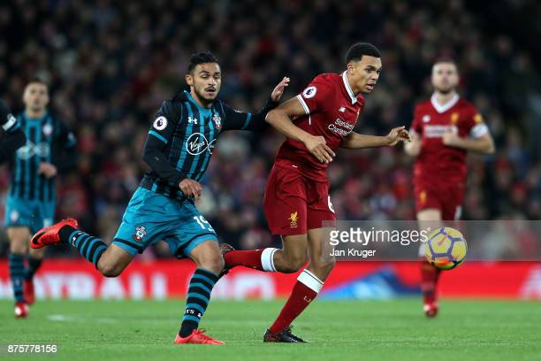 Trent Alex Arnold of Liverpool and Sofiane Boufal of Southampton compete for the ball during the Premier League match between Liverpool and...