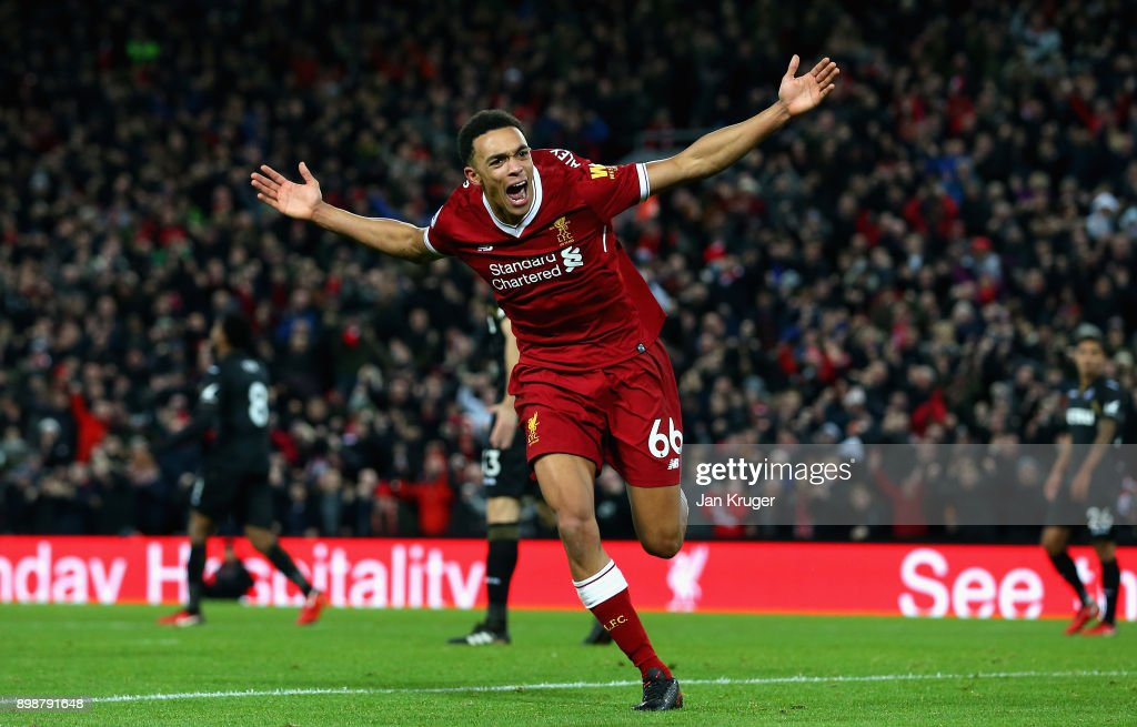 Trent Alex Arnold of Liverpool celebrates after scoring his sides third goal during the Premier League match between Liverpool and Swansea City at Anfield on December 26, 2017 in Liverpool, England.