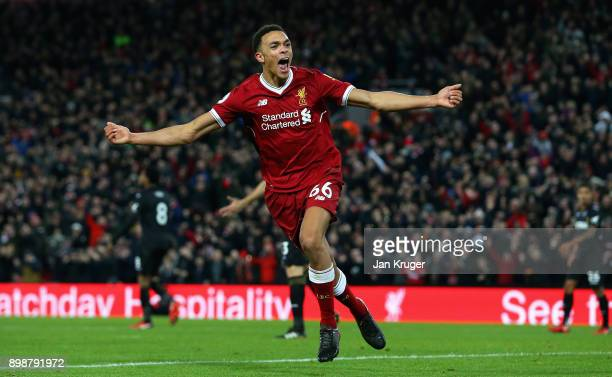 Trent Alex Arnold of Liverpool celebrates after scoring his sides third goal during the Premier League match between Liverpool and Swansea City at...