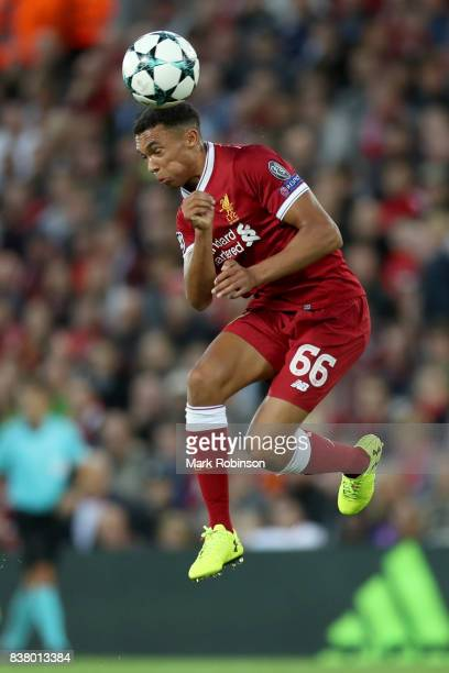 Trent Alex Arnold of Liverpool heads the ball during the UEFA Champions League Qualifying PlayOffs round second leg match between Liverpool FC and...