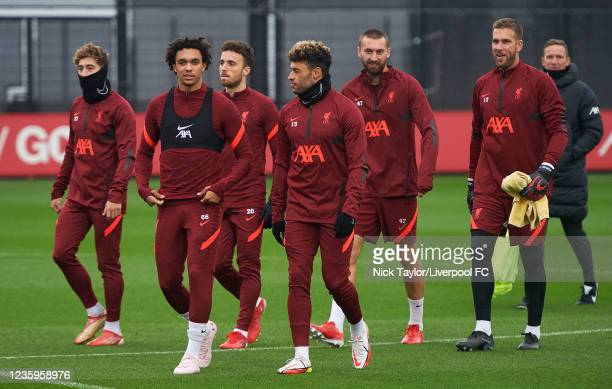 Trent Alexander-Arnold, Alex Oxlade-Chamberlain, Nathaniel Phillips and Adrian of Liverpool during a training session at AXA Training Centre on...