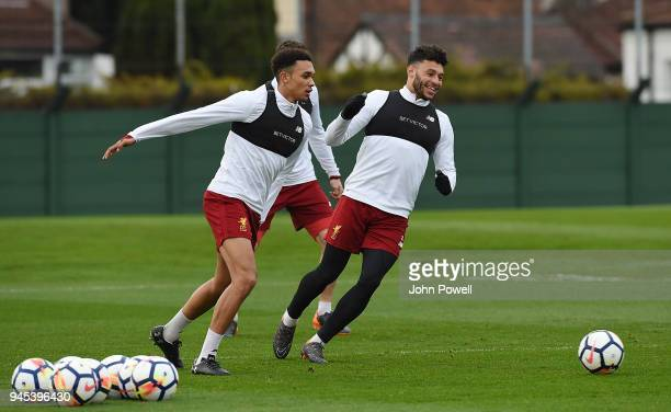 Trent AlexanderArnold and Alex OxladeChamberlain of Liverpool during a training session at Melwood Training Ground on April 12 2018 in Liverpool...