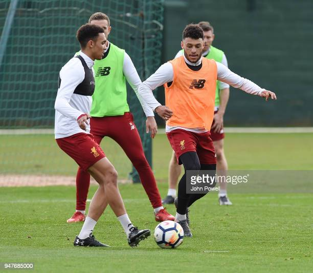 Trent AlexanderArnold and Alex OxladeChamberlain of Liverpool during a training session at Melwood Training Ground on April 17 2018 in Liverpool...
