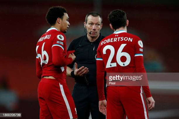 Trent Alexander-Arnold and Andy Robertson of Liverpool speak with Referee Kevin Friend during the Premier League match between Liverpool and Brighton...