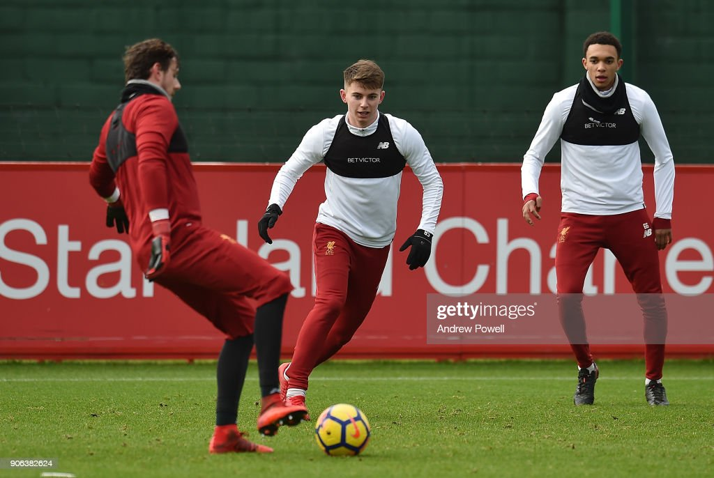Trent Alexander-Arnold and Ben Woodburn of Liverpool during a training session at Melwood Training Ground on January 18, 2018 in Liverpool, England.