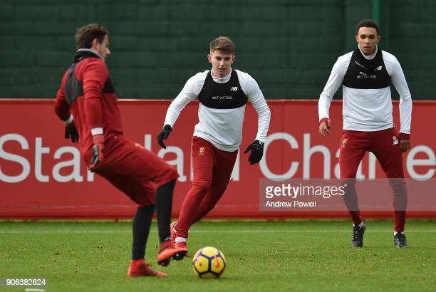 Trent AlexanderArnold and Ben Woodburn of Liverpool during a training session at Melwood Training Ground on January 18 2018 in Liverpool England
